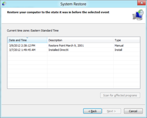 System Restore displays a list of restore points, their date, and a brief description.